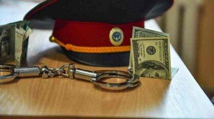 $26 800 получил полицейский в Алматы за прекращение уголовного дела
